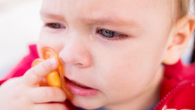 Funny baby. Cry. Crying. Blue eye. Stock Photos