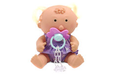 Funny baby doll with dummy. Isolated over white Stock Photo