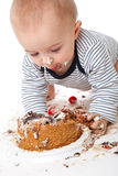 A funny baby is eating a tasty cake Stock Photography