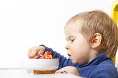 Funny Baby eats vegetable soup spoon Stock Photos