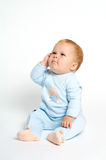 Funny baby expression. Funny baby sitting with expression Stock Photography