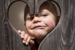 Funny baby face peeking out Stock Images