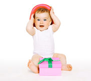 Funny baby with gift Royalty Free Stock Photo