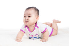 Funny baby girl crawling on floor Royalty Free Stock Image