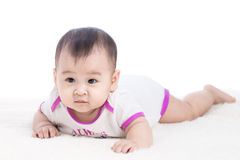Funny baby girl crawling on floor Royalty Free Stock Images