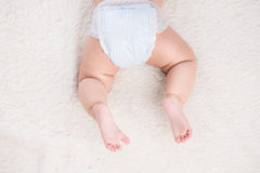 Funny baby girl crawling on floor Stock Photography
