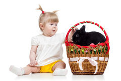 Funny baby girl with Easter bunny in basket stock image