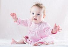 Funny baby girl giving a hug Royalty Free Stock Photo