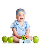 Funny baby girl with green apples Royalty Free Stock Image
