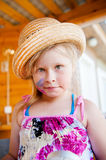 Funny baby girl in hat. And painted with paints cheek Stock Images