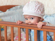 Funny baby girl in hat standing stock image