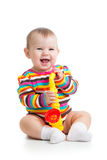 Funny baby girl with musical toy isolated Stock Photography