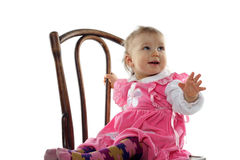 Funny baby girl in pink dress Stock Photos