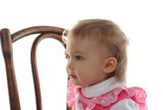 Funny baby girl in pink dress Stock Photography