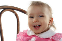 Funny baby girl in pink dress Royalty Free Stock Image