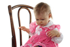 Funny baby girl in pink dress Royalty Free Stock Images