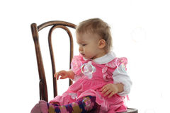 Funny baby girl in pink dress Royalty Free Stock Photography
