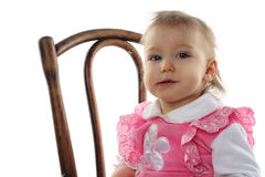 Funny baby girl in pink dress Stock Photo