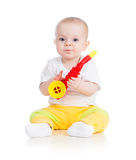 Funny baby girl playing. Funny baby  girl playing with musical toy on white background Royalty Free Stock Photo