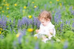 Funny baby girl playing in a garden Royalty Free Stock Photography