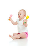 Funny baby girl playing with musical toy Stock Image