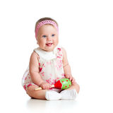 Funny baby girl playing with musical toy Royalty Free Stock Photography