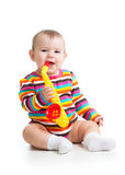 Funny baby girl playing with musical toy isolated Royalty Free Stock Photos