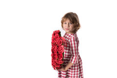 Funny baby girl in red checkered dress with  heart of red flower. Funny child girl in red checkered dress with a heart of red flowers, and the concept of Royalty Free Stock Photography