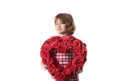 Funny baby girl in red checkered dress with  heart of red flower. Funny child girl in red checkered dress with a heart of red flowers, and the concept of Stock Images