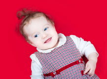 Funny baby girl in red Christmas dress Royalty Free Stock Image