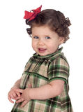 Funny baby girl with red loop. Isolated over white background Royalty Free Stock Photography