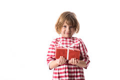 Funny baby girl in red plaid dress with  gift, concept of Valent Stock Image