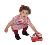 Funny baby girl with red telephone Royalty Free Stock Photos