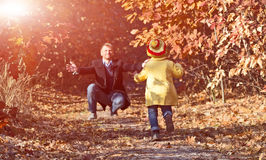 Funny Baby Girl Running towards her Father on Forest Trail Stock Photos