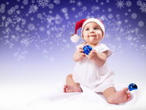 Funny baby girl in santas hat Royalty Free Stock Photo