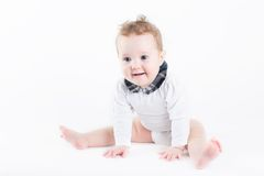 Funny baby girl sitting with a white background Royalty Free Stock Photo