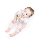 Funny baby girl sitting on white background Royalty Free Stock Images