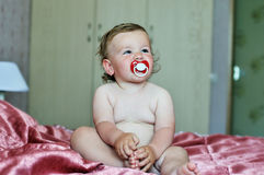 Funny baby girl with soother Royalty Free Stock Photo