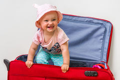 Funny baby girl in suitcase Royalty Free Stock Photos