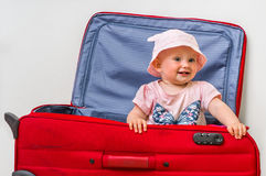 Funny baby girl in suitcase Stock Photography