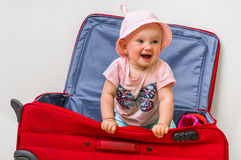 Funny baby girl in suitcase Royalty Free Stock Images