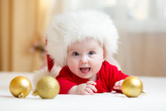 Funny baby girl weared in Santa hat stock photos