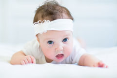 Funny baby girl with a white bow. Funny little baby girl with a white bow Royalty Free Stock Photo