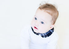 Funny baby girl in a white shirt with black collar Royalty Free Stock Images