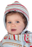 Funny baby girl with winter clothing Stock Photography
