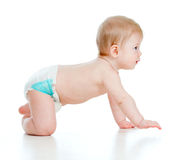 Funny baby goes down on all fours Royalty Free Stock Photography