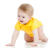 Funny baby goes down on all fours. Cute baby goes down on all fours Royalty Free Stock Images