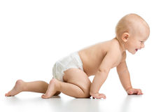 Funny baby goes down on all fours Stock Photos