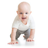 Funny baby goes down on all fours Royalty Free Stock Photos