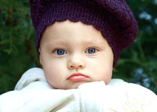 Funny baby in hat outdoors stock image